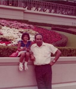 Famin and her father at Disney World.